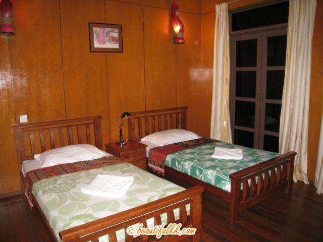 Nicely Decorated Twin Beds at the Standard Chalet