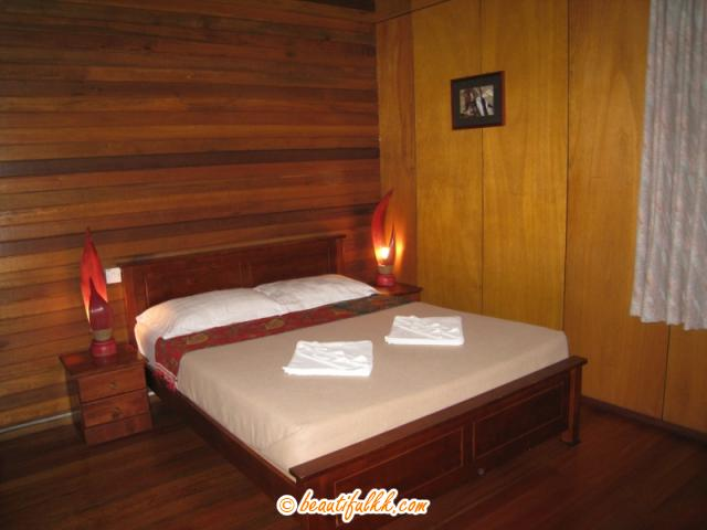 A Queen Bed at the Deluxe Chalet